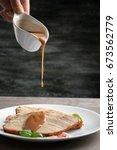 pouring tasty turkey gravy onto ... | Shutterstock . vector #673562779