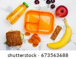 lunch box  sandwich and fruits. ... | Shutterstock . vector #673563688