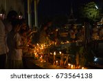 Small photo of UDON, THAILAND - JULY 8: Buddhists are worshiped all day. From the precepts, preaching, sermon, walking Buddha, such as around the church on Asaha Puja Day, on the july 8, 2017 in UDON, THAILAND