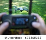drone viewed through the... | Shutterstock . vector #673565383