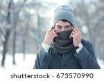 outdoor portrait of young man... | Shutterstock . vector #673570990