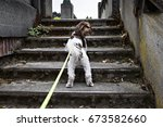Stock photo walking the dog up the stairs in seattle 673582660