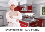 Female chef with old book in a kitchen interior - stock photo
