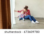 young mother holding her young... | Shutterstock . vector #673609780