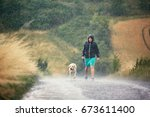 young man walking with his dog  ... | Shutterstock . vector #673611400