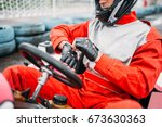 go kart driver in helmet on... | Shutterstock . vector #673630363