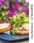 Small photo of Grilled ahi tuna steak topped with arugula served on a bun