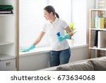 Happy Young Woman Cleaning The...