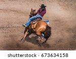 Cowgirl Riding Her Horse In A...