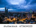 Wallpaper magical night of the city of Bogota. Dark blue cloudy sky