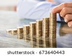 business person placing coin... | Shutterstock . vector #673640443