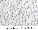 white pills  white background | Shutterstock . vector #673662823