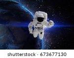 astronaut in galaxy. elements... | Shutterstock . vector #673677130