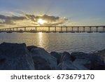 brilliant sun coming up over... | Shutterstock . vector #673679170