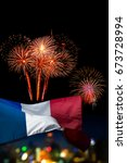 Small photo of Beautiful holiday fireworks and france flag with (bokek background) blured cityscapes in night La Fete Nationale (Bastille Day) is celebration of french national holiday