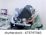 surgical robot. | Shutterstock . vector #673747360