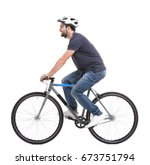 Small photo of Handsome young man riding bicycle on white background