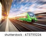 high speed train in motion at... | Shutterstock . vector #673755226