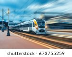 high speed train at the railway ... | Shutterstock . vector #673755259