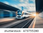 high speed train at the railway ... | Shutterstock . vector #673755280