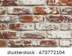 Red Brick Wall With White Pain...