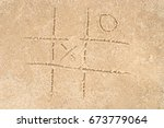 Tic Tac Toe Drawing In Sand...
