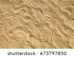 Footprints In Sand On Playpit....