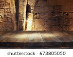 empty old table in front of... | Shutterstock . vector #673805050