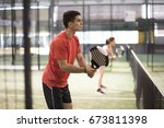 paddle tennis couple in court... | Shutterstock . vector #673811398