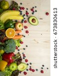 vegetables and fruits on wood... | Shutterstock . vector #673830613
