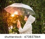 woman in white raincoat... | Shutterstock . vector #673837864