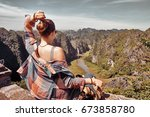 portrait of woman with backpack ...   Shutterstock . vector #673858780
