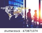 Small photo of Silhouette of a two successful colleagues entrepreneurs discussing ideas while standing near big office window, colleagues talking, infographics element world map with international business services