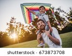 handsome dad with his little... | Shutterstock . vector #673873708