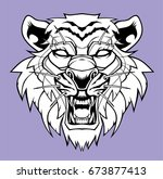 angry tiger head logo. | Shutterstock .eps vector #673877413