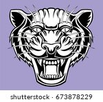 angry panther head logo.   Shutterstock .eps vector #673878229