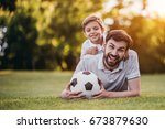handsome dad with his little... | Shutterstock . vector #673879630