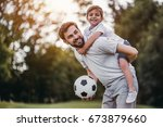 handsome dad with his little... | Shutterstock . vector #673879660