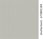 abstract knit texture. gray... | Shutterstock .eps vector #673881184