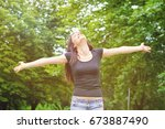 young smiling woman in sunny... | Shutterstock . vector #673887490
