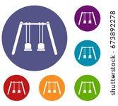 wooden swings hanging on ropes... | Shutterstock .eps vector #673892278