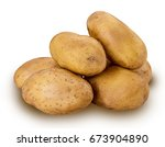 heap of young potatoes isolated ... | Shutterstock . vector #673904890