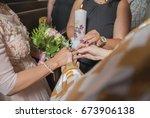 wedding ceremony of putting on... | Shutterstock . vector #673906138