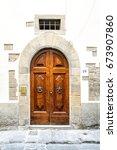 old wooden door with knockers | Shutterstock . vector #673907860