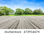 board platform and green tree | Shutterstock . vector #673916674
