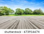 board platform and green tree | Shutterstock . vector #673916674