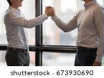 business partners giving fist... | Shutterstock . vector #673930690