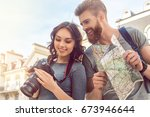 young couple tourists city walk ... | Shutterstock . vector #673946644