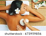 view of young woman in spa... | Shutterstock . vector #673959856