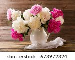 bouquet of colorful peonies... | Shutterstock . vector #673972324